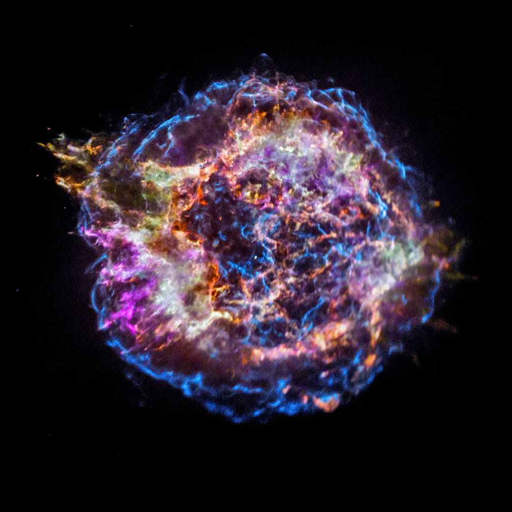 The remnants of an exploded star, or supernova, known as Cassiopeia A shown in a burst of orange, blue and purple by NASA's Chandra X-ray Observatory