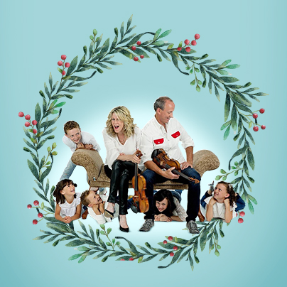 Natalie MacMaster, Donnell Leahy and family in a Christmas card-style photo
