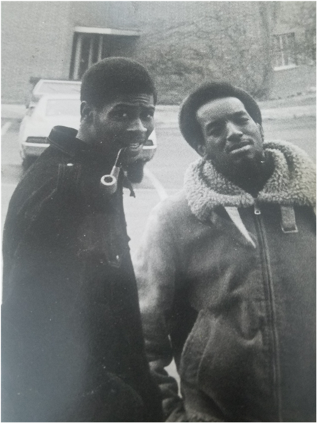 Black and white photo with Moore, on the right, standing with fraternity brother outside Holden Hall, 1973.