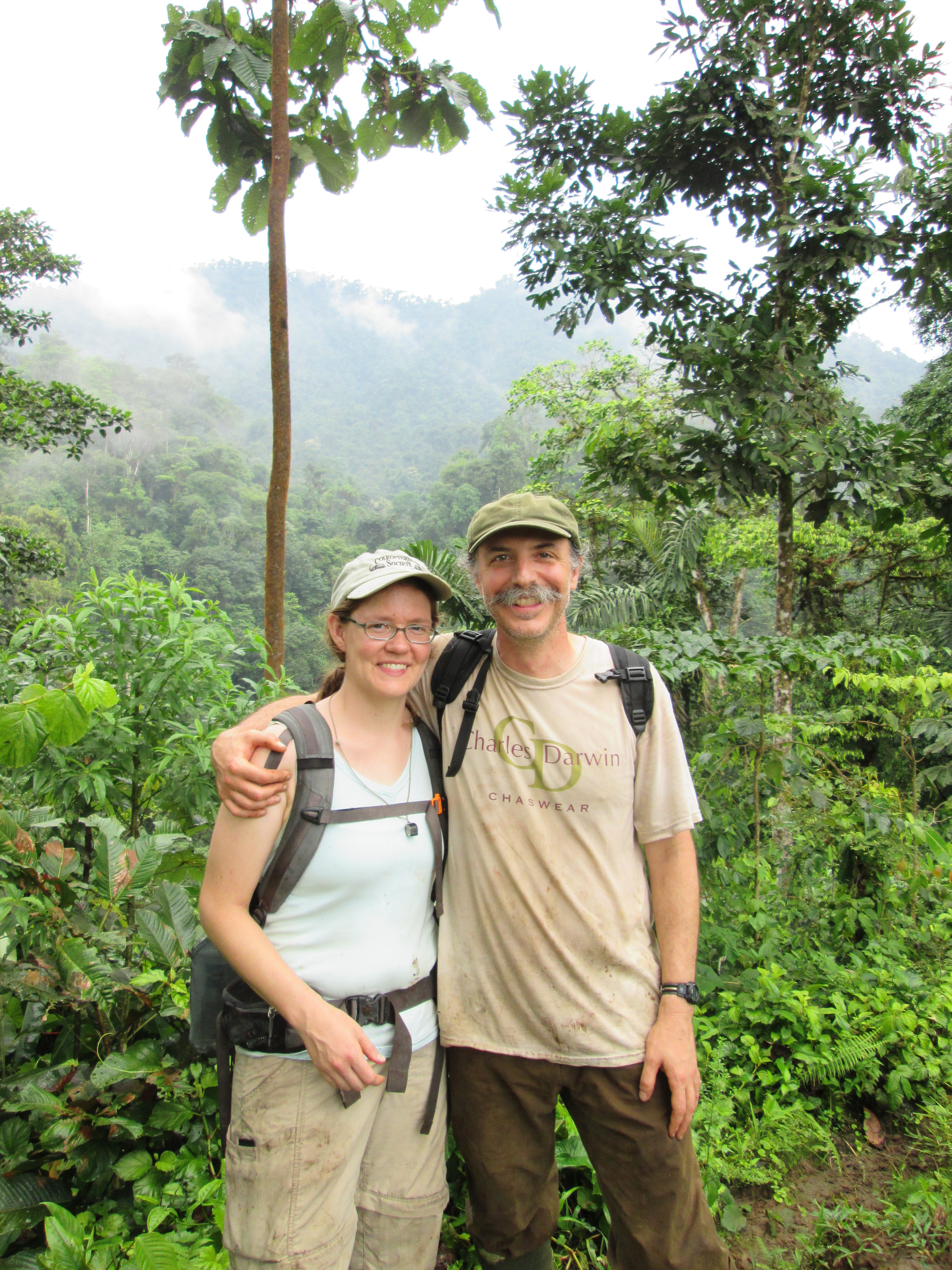 Sarah Smith and Anthony Cognato are photographed in front of dense green foliage and misty hilltops in Ecuador in 2015.