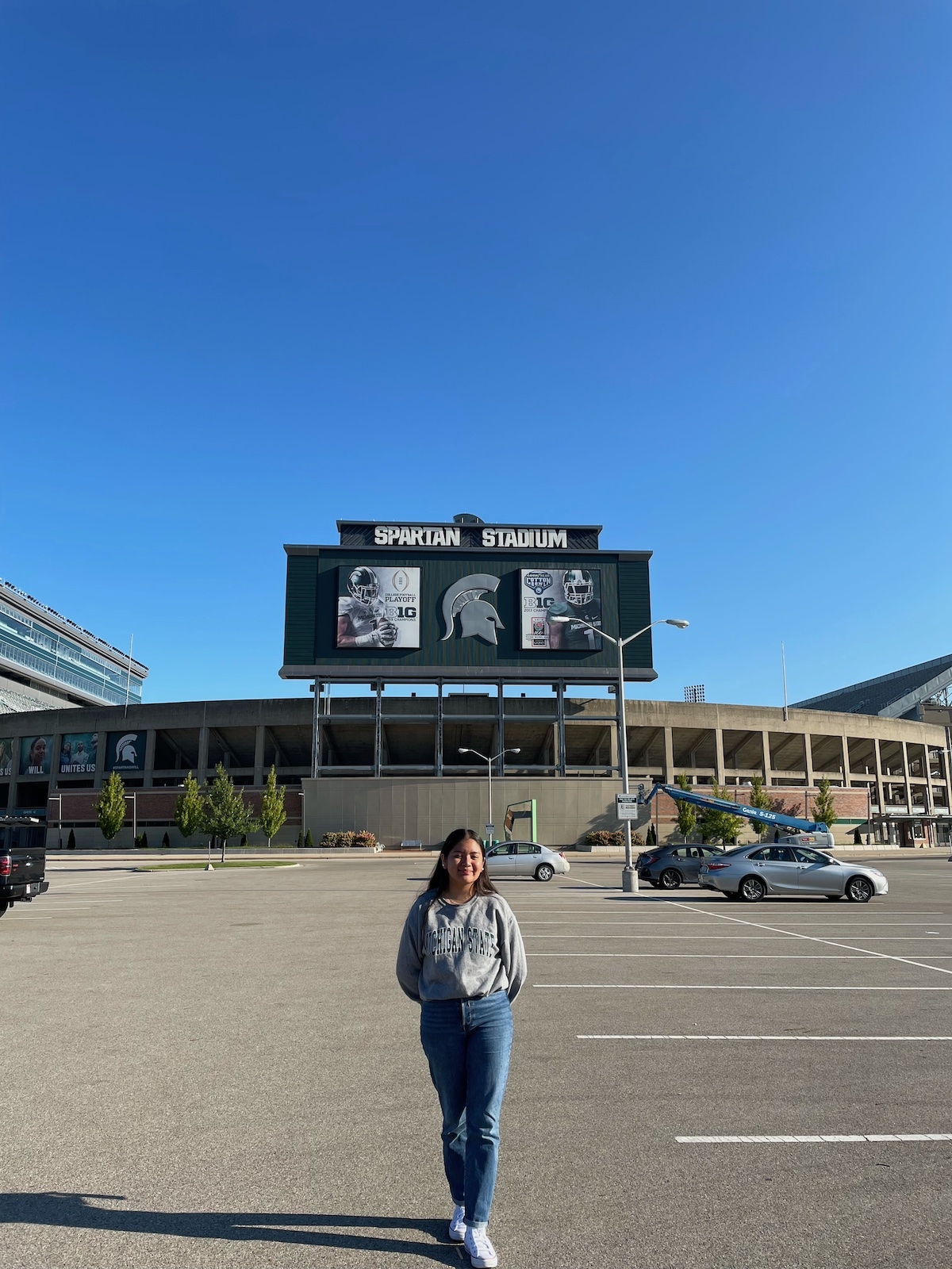 Luz Vazquez Hernandez's first day on campus standing with Spartan Stadium in the background.