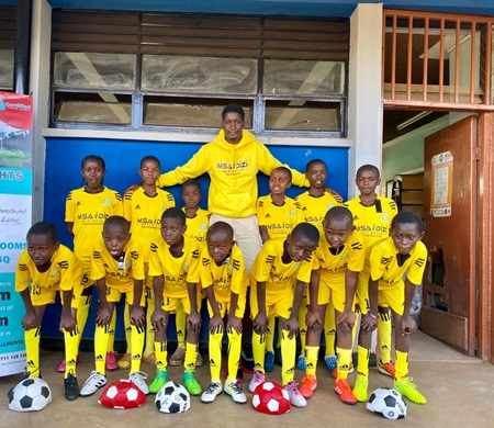 Pius Mithika and the youth soccer team he mentors.