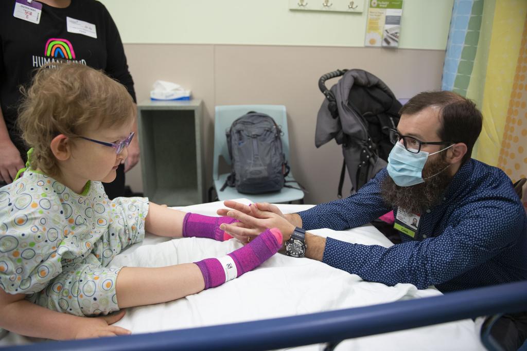 Dr. Caleb Bupp examines Bachmann-Bupp Syndrome patient Marley